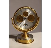 Pendule circulaire en laiton doré Jean ROULET
