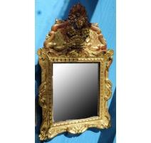 Miroir en bois sculpté doré style Régence
