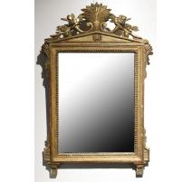 Miroir Empire, fronton sculpté de fleurs et gerbe