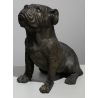 Bronze Bulldog assis