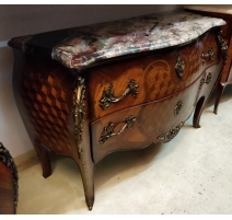 Commode style Louis XV ventrue en bois de rose