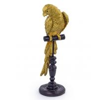 Perroquet doré en résine sur son perchoir