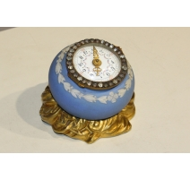 Small table clock, in porcelain and bronze