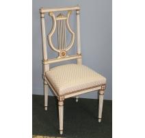 Paire de chaises lyre style Louis XVI laquées