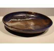 Plat en céramique bleu et brune signé DOUGOUD