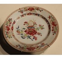Assiette en porcelaine décor fleur et plat courge