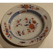 Assiette en porcelaine décor fleurs et insectes