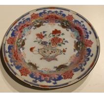 Assiette en porcelaine décor vase de fleurs
