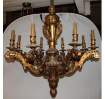 Lustre en bois sculpté doré à 8 lumières