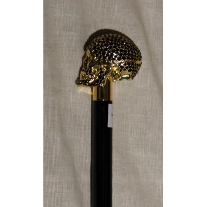 Bastón con pomo de cráneo de oro y negro