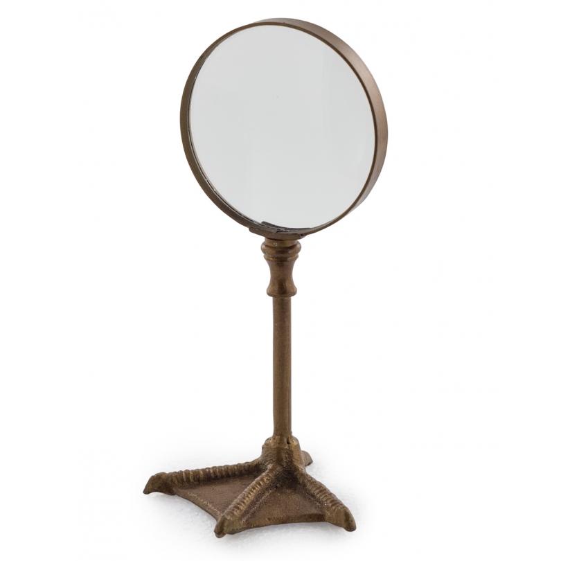放大镜爪子鸟的镀金的铜