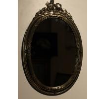Miroir ovale décor noeud en laiton