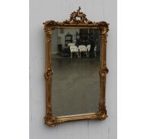 Miroir Louis XV-Napoléon III en bois sculpté doré
