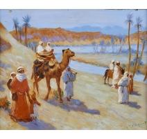 """Tableau """"Caravane dans le désert"""" signé V. HUGUET"""