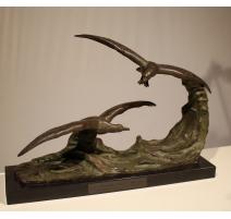 """Bronze """"Mouettes sur une vague"""" signé OULINE"""