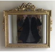 Miroir style Louis XVI fronton noeud en bois doré