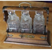 Tantalus avec 3 carafes en cristal