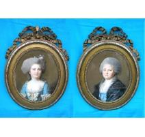 """Paire de pastels ovales """"Portraits""""."""