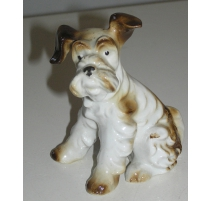 "Sculpture Chien assis ""Terrier"", en porcelaine."